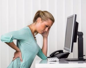 office-worker-needing-chiropractic-care-west-palm-beach-florida